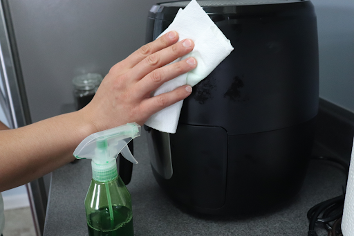 wiping-outside-of-air-fryer